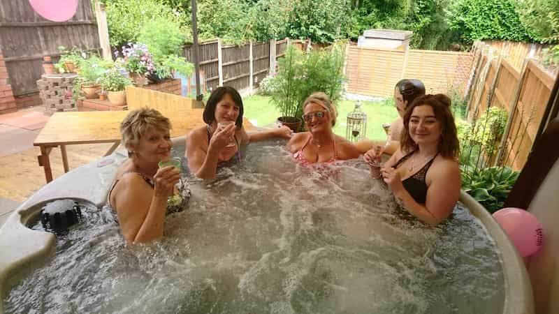 Burton hot tub party hire with 4 women enjoying a glass of bubbly